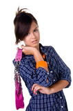 Modern Teenage Girl. Beautiful teenage girl in a casual blue shirt dress with a pink leather purse royalty free stock photo