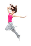 Modern teenage girl dancer jumping and dancing. Hip-hop isolated on a white background royalty free stock photography