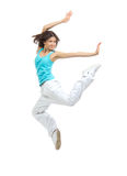 Modern teenage girl dancer jumping and dancing Stock Photography