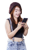 Modern teenage girl texting with a smartphone Stock Image