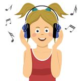 Modern teenager girl listening to music in headphones. Modern teenager girl listening to the music in headphones Stock Image