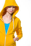 Modern teenager girl in sweater with draped hood Royalty Free Stock Photos