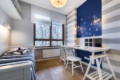 Modern teenager room in maritime style. With blue wall Royalty Free Stock Photos