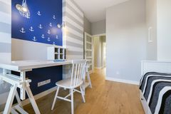 Modern teenager room in maritime style. With blue wall Stock Image