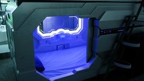 Modern teknologi - sleepbox med neonljus, ställe för utrymmekapsel för att sova på flygplatsen arkivfoton