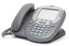 Modern telefon för kontorssystem med den stora LCD-skärmen Isolerat på wh Royaltyfri Foto