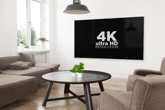 Modern television 4k. Modern panoramic smart tv on a 3d rendering living room with 4k on screen Royalty Free Illustration