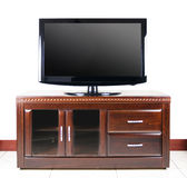 Modern television on wooden cabinet Royalty Free Stock Photography