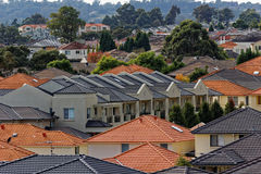 Modern terraced houses in landscaped district. Scenery of modern terraced homes in a landscaped district of Sydney (Australia) - contemporary living Stock Photo