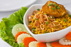 Modern thai food, Saffron rice with chiken. Thai food Saffron rice with chiken is a rice baking  with yellow curry powder, spices , vegetables and chiken Royalty Free Stock Photo