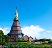 The modern thai style pagoda with blue sky and garden in Thailan Royalty Free Stock Photo