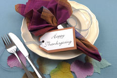 Modern Thanksgiving dining table place setting with autumn leaves Stock Image