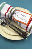 Modern Thanksgiving dining table setting on aqua tablecloth. Close up. Stock Photo
