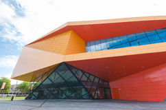 Modern theater. Exterior of the agora theater in lelystad, netherlands. The orange building is designed by Ben van Erkel, who got inspired by the always changing Royalty Free Stock Photos