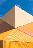 Modern theater. Exterior of the agora theater in lelystad, netherlands. The orange building is designed by Ben van Erkel, who got inspired by the always changing Stock Photo