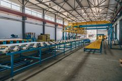 Modern thermal insulation sandwich panel production line. Machine tools, roller conveyor and overhead crane in workshop.  stock images