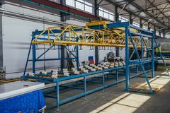 Modern thermal insulation sandwich panel production line. Machine tools, roller conveyor in workshop.  stock photos