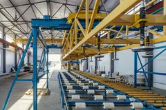Modern thermal insulation sandwich panel production line. Machine tools, roller conveyor in workshop.  royalty free stock photos