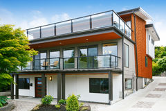 Modern three level house exterior with wooden trim Stock Photography