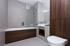 Modern three piece bathroom suite. Contemporary three piece bathroom suite with modern bath tub, ceramic square sink and toilet stock image