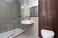 Modern three piece bathroom suite. Contemporary three piece bathroom suite with modern shower, ceramic square sink and toilet Stock Images