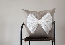 Throw pillow with white bow for home decor Royalty Free Stock Images