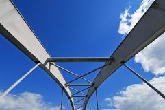 Modern tied arch bridge against cloudy blue sky Stock Photography