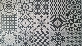 Tile designs in white and black grey colors royalty free stock photo