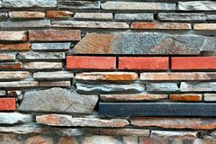 Modern Tiled  Wall From Natural Mixed Stone Royalty Free Stock Image