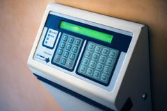 Modern time clock with digital display on wall. STRASBOURG, FRANCE - SEPTEMBER 21, 2014: Device for payroll record with time clock seen outside an office - huma Royalty Free Stock Images