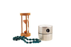 Modern timer, old sandglass and bead Royalty Free Stock Images