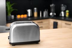 Modern toaster on table in kitchen. Selective focus royalty free stock photos