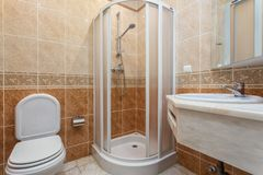 Modern Toilet Bathroom With Shower Inside In Hotel. Royalty Free Stock Photography