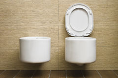 Modern toilet with beige tile on wall Royalty Free Stock Photography