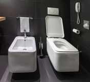 Modern toilet and bidet in bathroom Royalty Free Stock Image