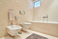 Modern toilet with ceramic tiles and bathroom. Stock Photo