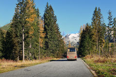 The modern tourist bus on mountain road Stock Images