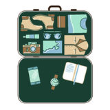 Modern tourist stuff in suitcase . Stock Image