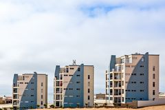 Modern touristic buildings of Dolfynstrand resort at the seaside royalty free stock photo