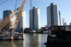 The modern and touristic port of Rotterdam on a sunny spring day. In the metropolis boats, ships and fishing boats wake up in the. Morning ready for work royalty free stock photography