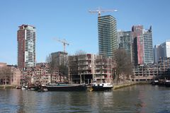 The modern and touristic port of Rotterdam on a sunny spring day. In the metropolis boats, ships and fishing boats wake up in the. Morning ready for work stock image
