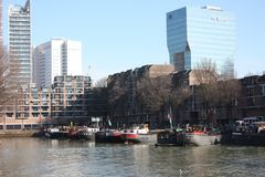 The modern and touristic port of Rotterdam on a sunny spring day. In the metropolis boats, ships and fishing boats wake up in the. Morning ready for work royalty free stock images