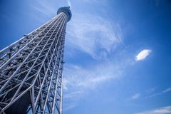 Modern tower against blue skies, Tokyo Stock Photo