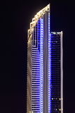 Modern tower building in blue at night Stock Images