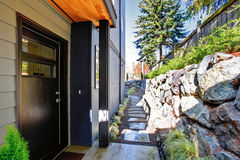 Modern town house walkway with black door. Stock Photos