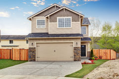 Modern town house with well kept lawn. Royalty Free Stock Photos