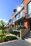 Modern townhouses stock images