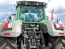 Modern tractor. Modern new tractor in rear view stock images