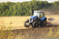 Modern tractor on the agricultural field Royalty Free Stock Image