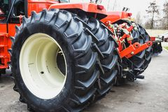 Modern Tractor Big Wheels close up, Modern Agricultural Generic Vehicle Stock Photo